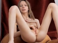 Rubbing her pinkish vagina gives girl enjoyable ecstasy