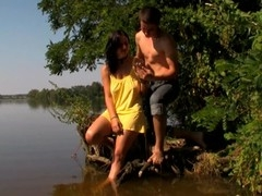 Legal Age Teenager slut begins satisfying her fuckmate with sex in the lake