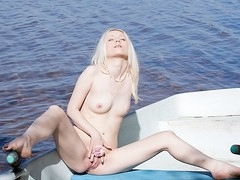 What can a beautiful golden-haired do all alone in a boat in the middle of a lake? Find out in this steamy art porn clip!
